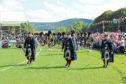 Lonach Highlanders march at the 2017 Lonach Gathering