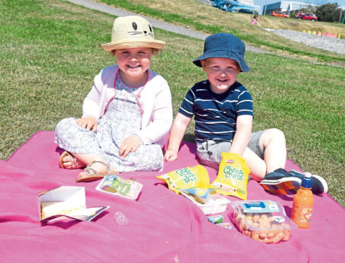 Cousins Charlotte Cuthill and Oliver Butcher, 2, tuck in to their lunch