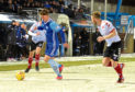 Aaron Norris (in Blue) in action for Peterhead.  Picture by Jim Irvine.