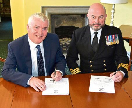 Bob MacDonald and Commander Andy Poulton-Watt sign the Armed Forces Covenant.