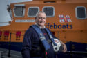 Bill Deans received the honour for services to the RNLI.