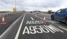 Road marking showing the A90's new name are visible on Wellington Road.