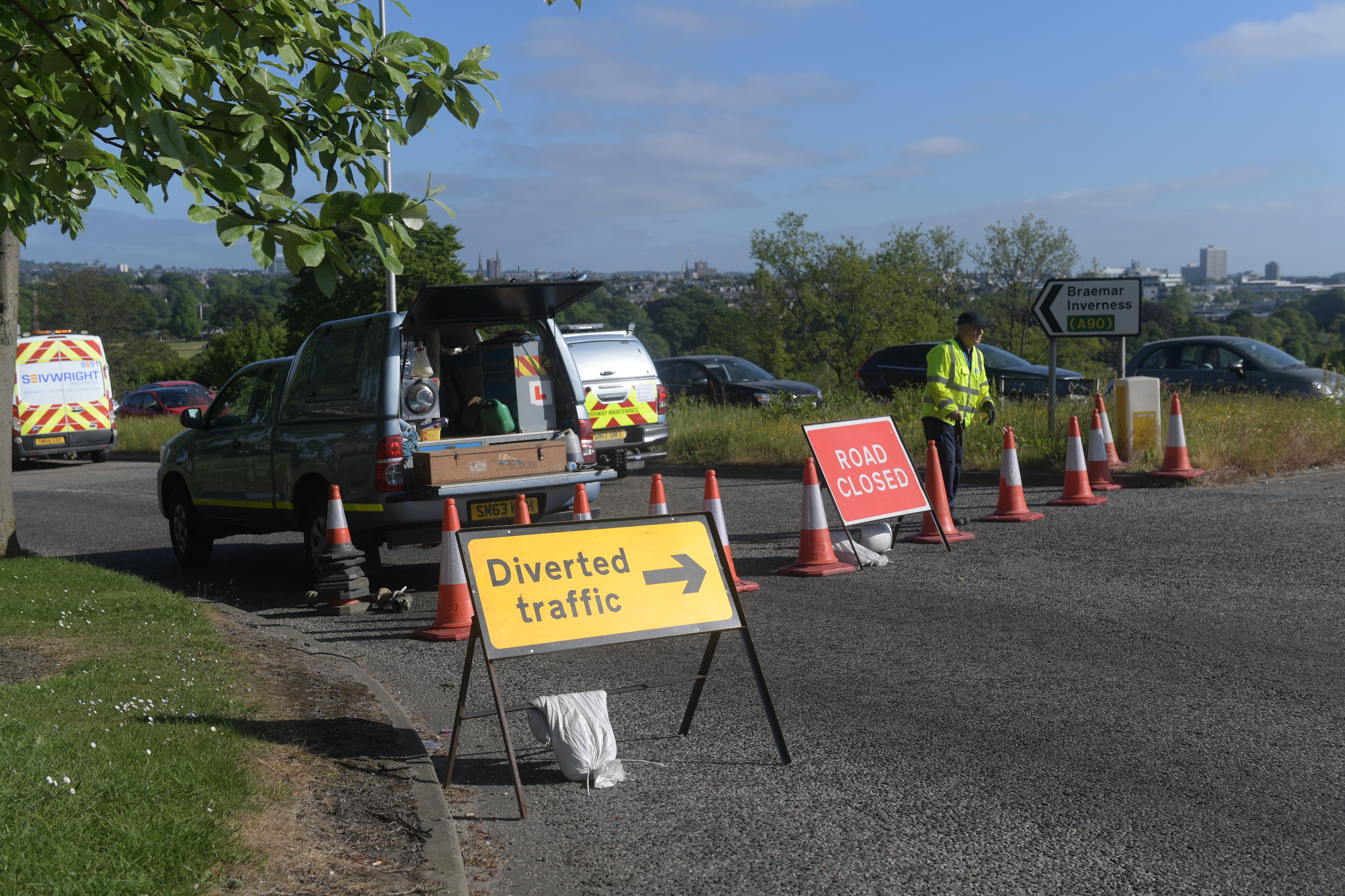 A stretch of West Tullos Road has been shut due to a burst water main.