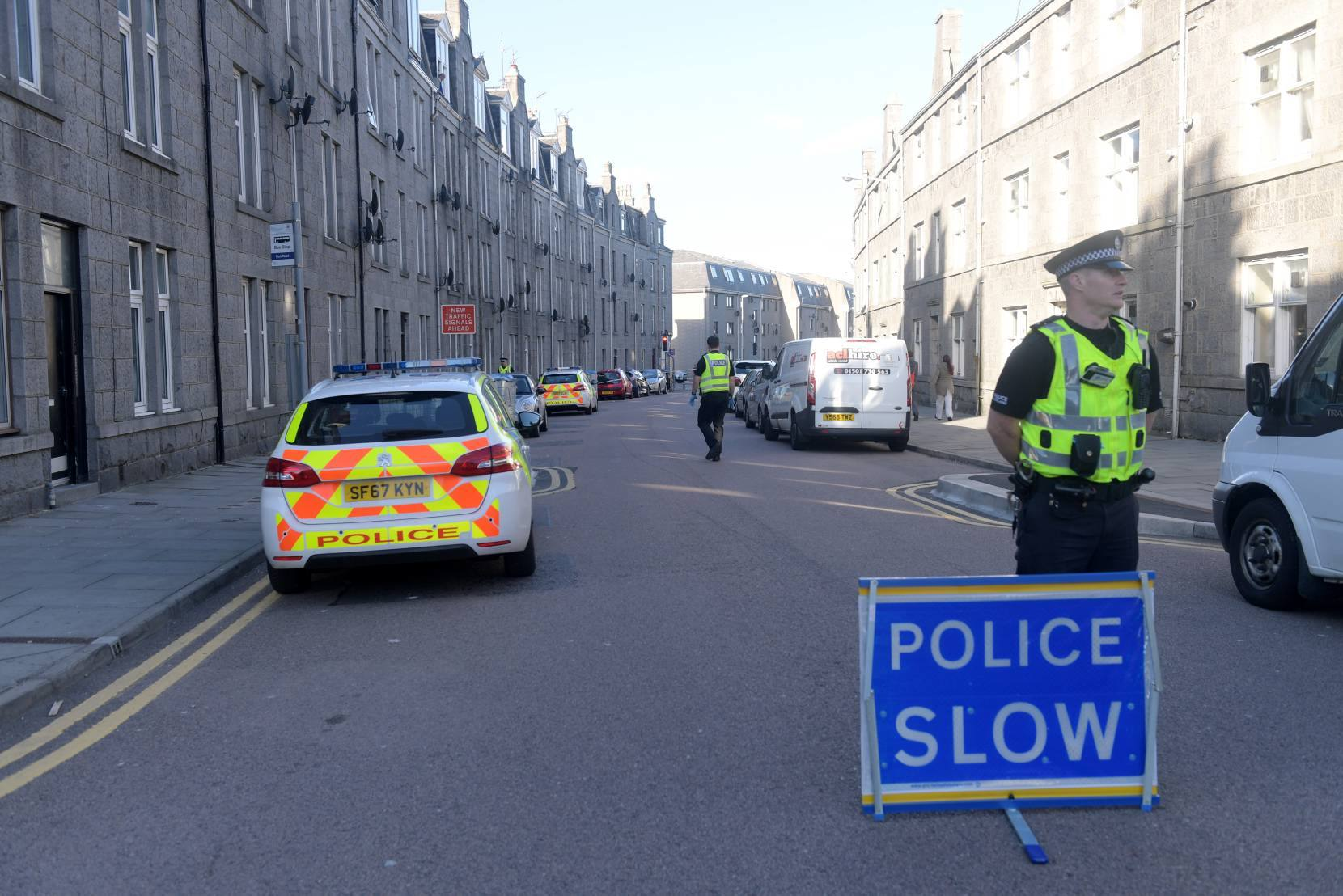 Police at the scene on Urquhart Road, Aberdeen, tonight