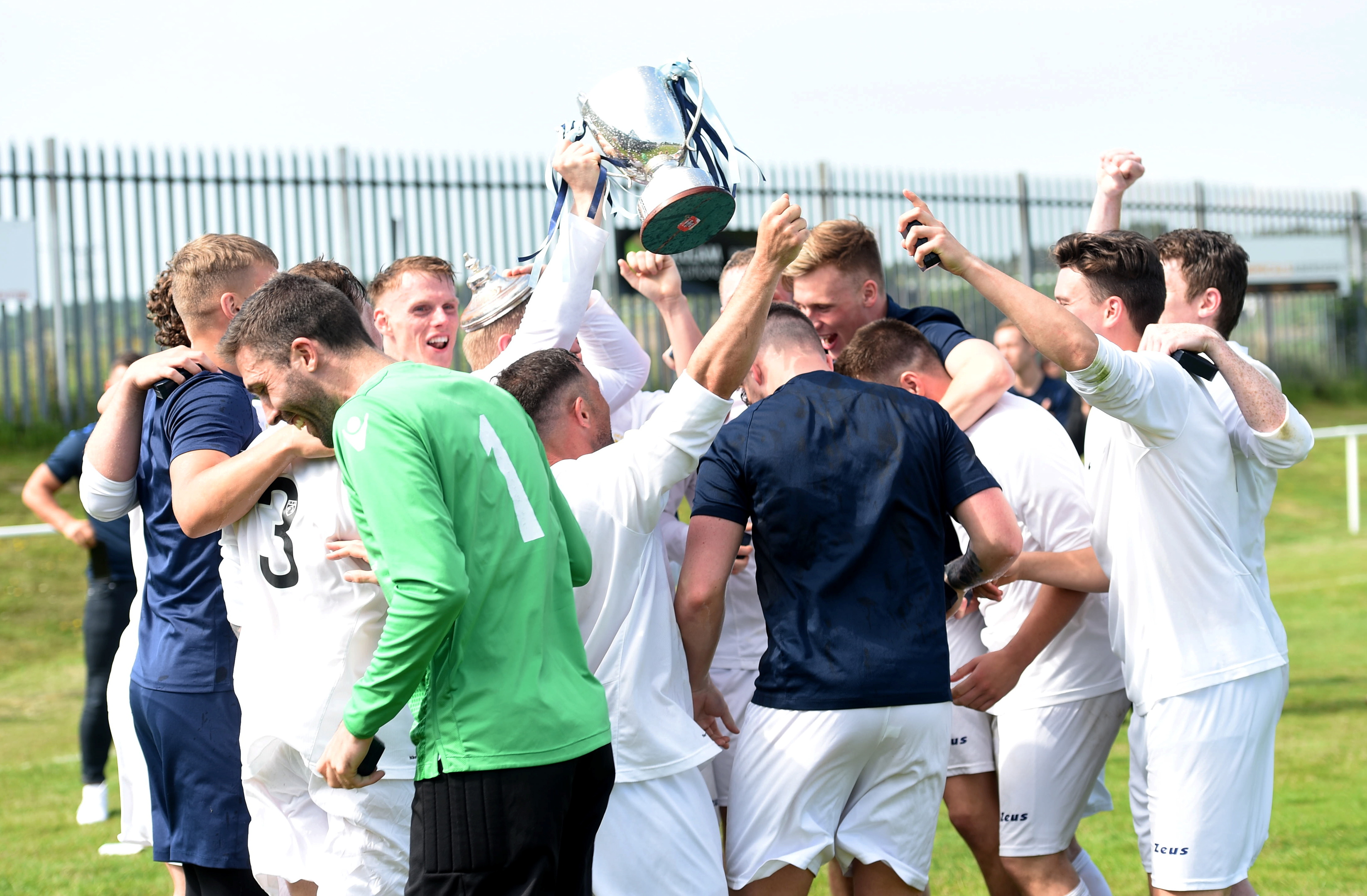 Dee players celebrating winning the cup. Picture by Darrell Benns