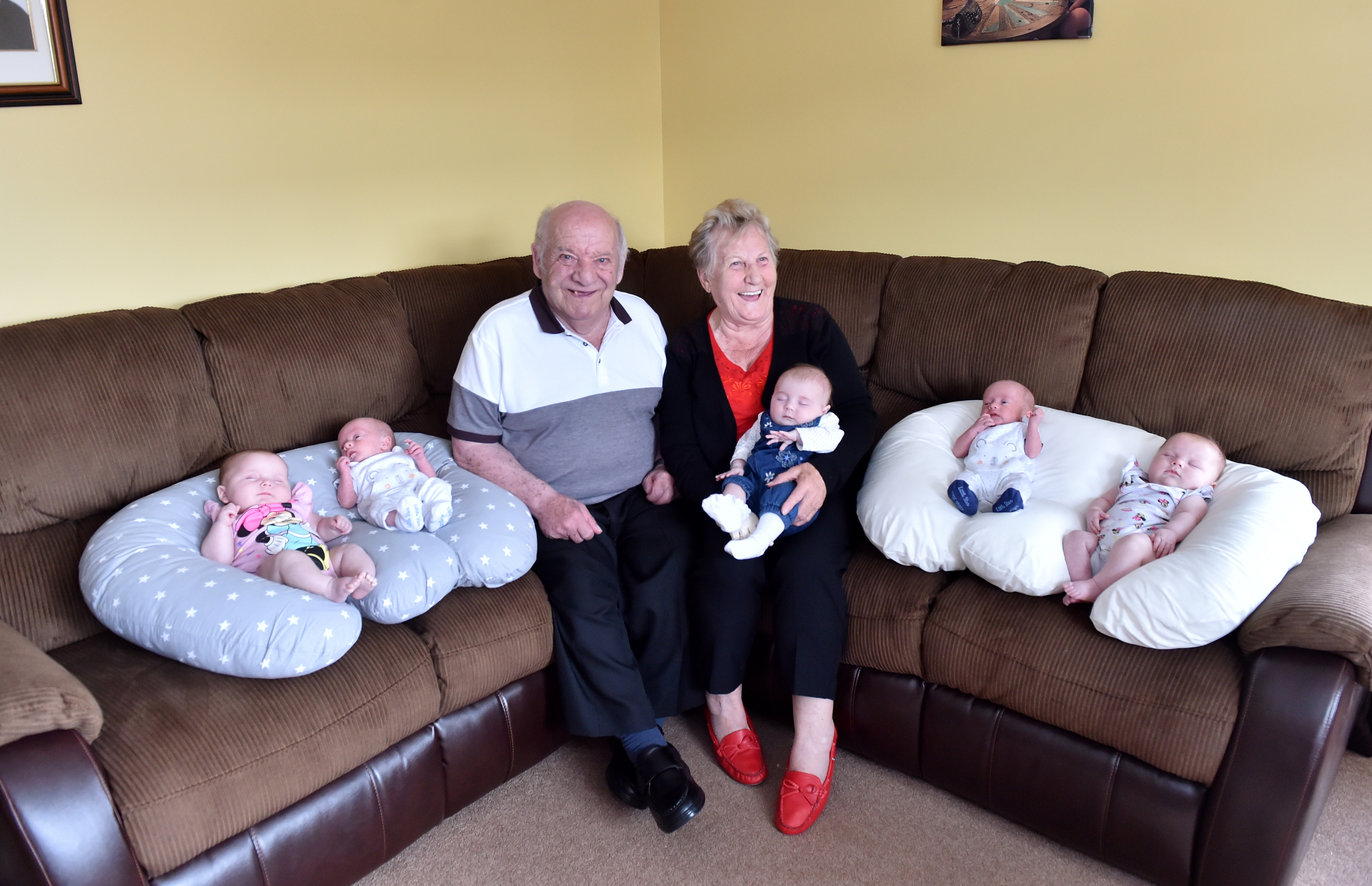 Great-grandparents Hugh and Bunty with their five new great-grandchildren.