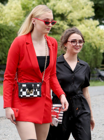 Sophie Turner and Maisie Williams arrive at the wedding of Kit Harington and Rose Leslie