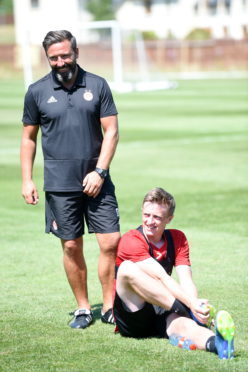 Pictured are manager Derek McInnes and Chris Forrester.