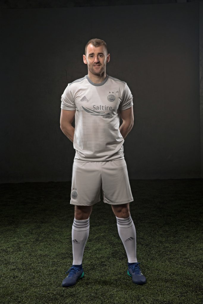 Niall McGinn modelling Aberdeen's away kit for the 2018/19 season. Picture courtesy of Aberdeen FC.