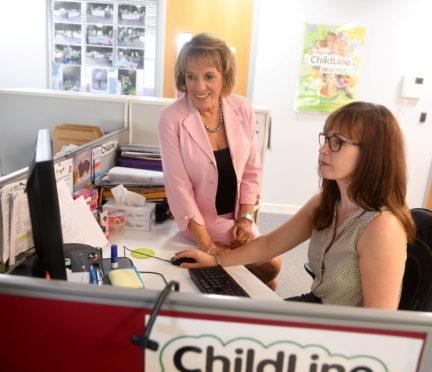 Dame Esther Rantzen with volunteer Kerri Stewart at Aberdeen's Childline