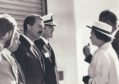 Stan MacLeod, with moustache, meets the Queen. He has died aged 69