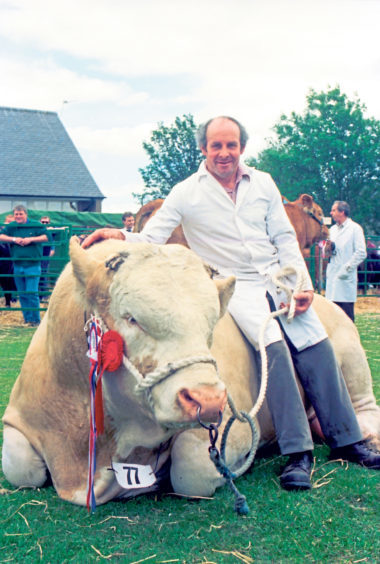 Stockman Gibby Scott with his Simmental bull owned by Sir Denis Mountain, Delfur Farms, Rothes, Moray. The Simmental went on to win the Overall Champion title at the show