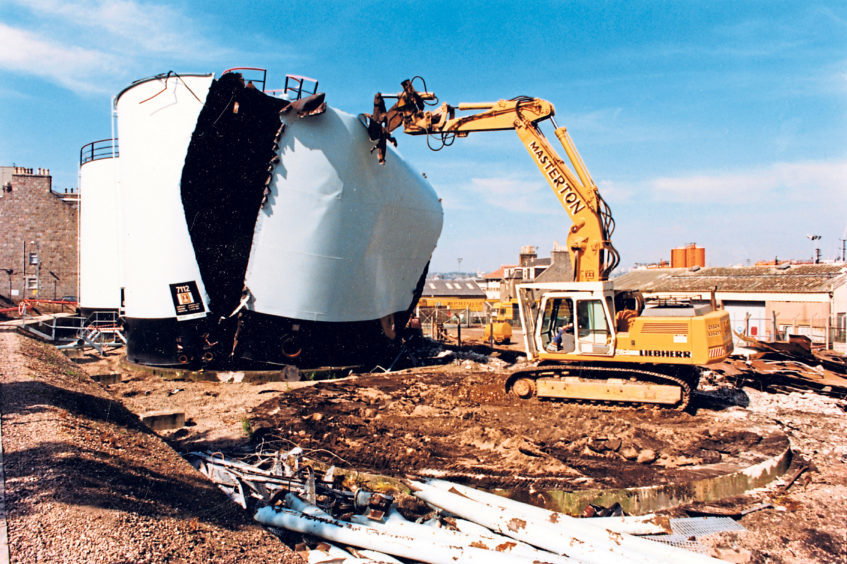Ripping apart the storage tanks at the Esso petroleum base in Abbey Road