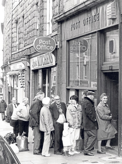 Pensioners and housewives line up outside Torry Post Office.