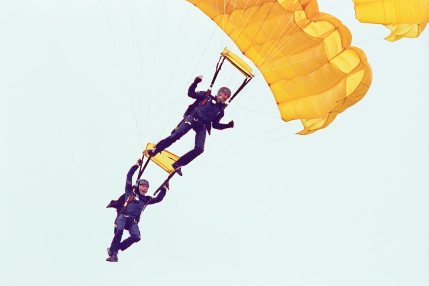 Two members of the Golden Lions Parachute Team make a dramatic entrance