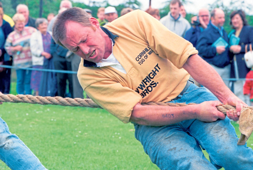 A member of the Cornhill tug of war team in action in 1999.