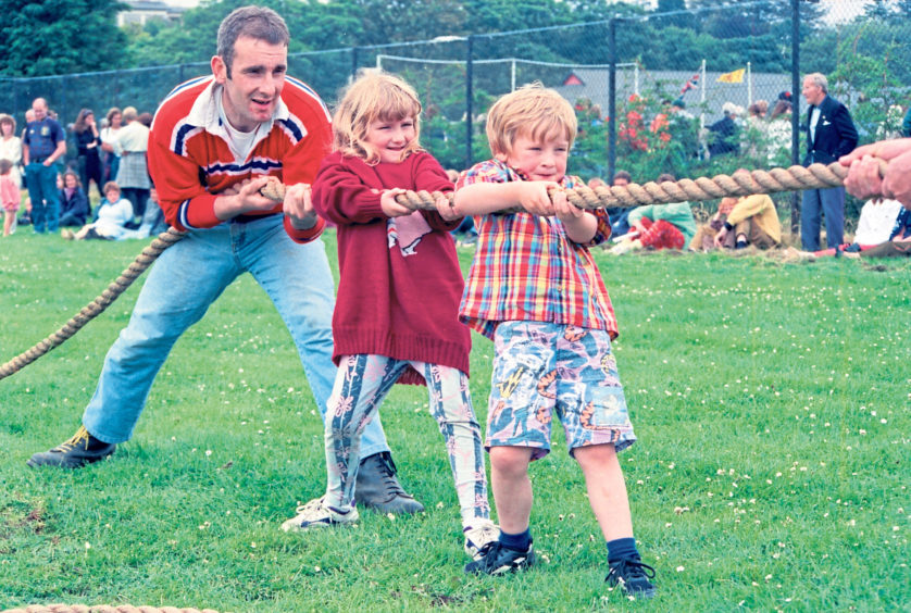 Gary Bruce, of the Kineff Young Farmers tug of war team, gets help from Mhari Meston, 8, and her six-year-old brother Euan