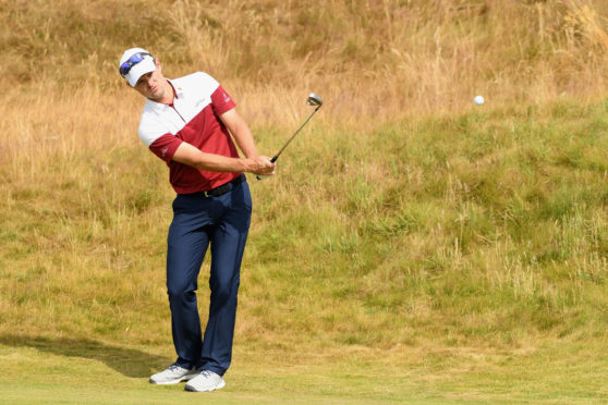 Justin Rose of England chips on the 10th hole during previews to the 147th Open Championship at Carnoustie Golf Club on July 16, 2018 in Carnoustie, Scotland.