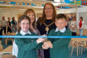 Pupils at Milne's Primary School get tour of £2 million extension, which has been completed in time for the last day of term