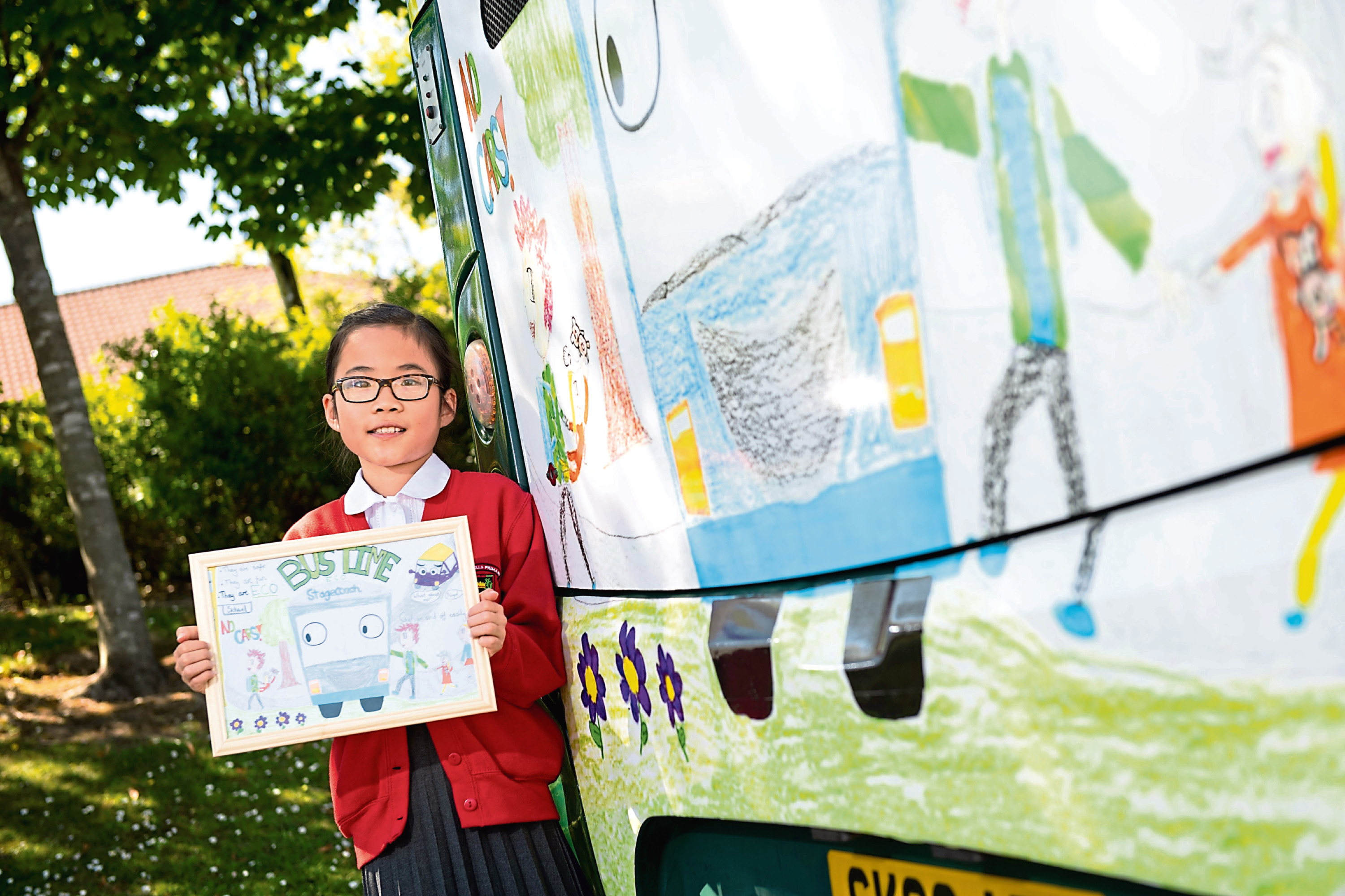 Jenny Lee, 11, with the bus featuring her artwork