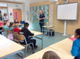 Gregor Townsend - alongside the Calcultta Cuo - speaking to pupils at Hazlehead Primary