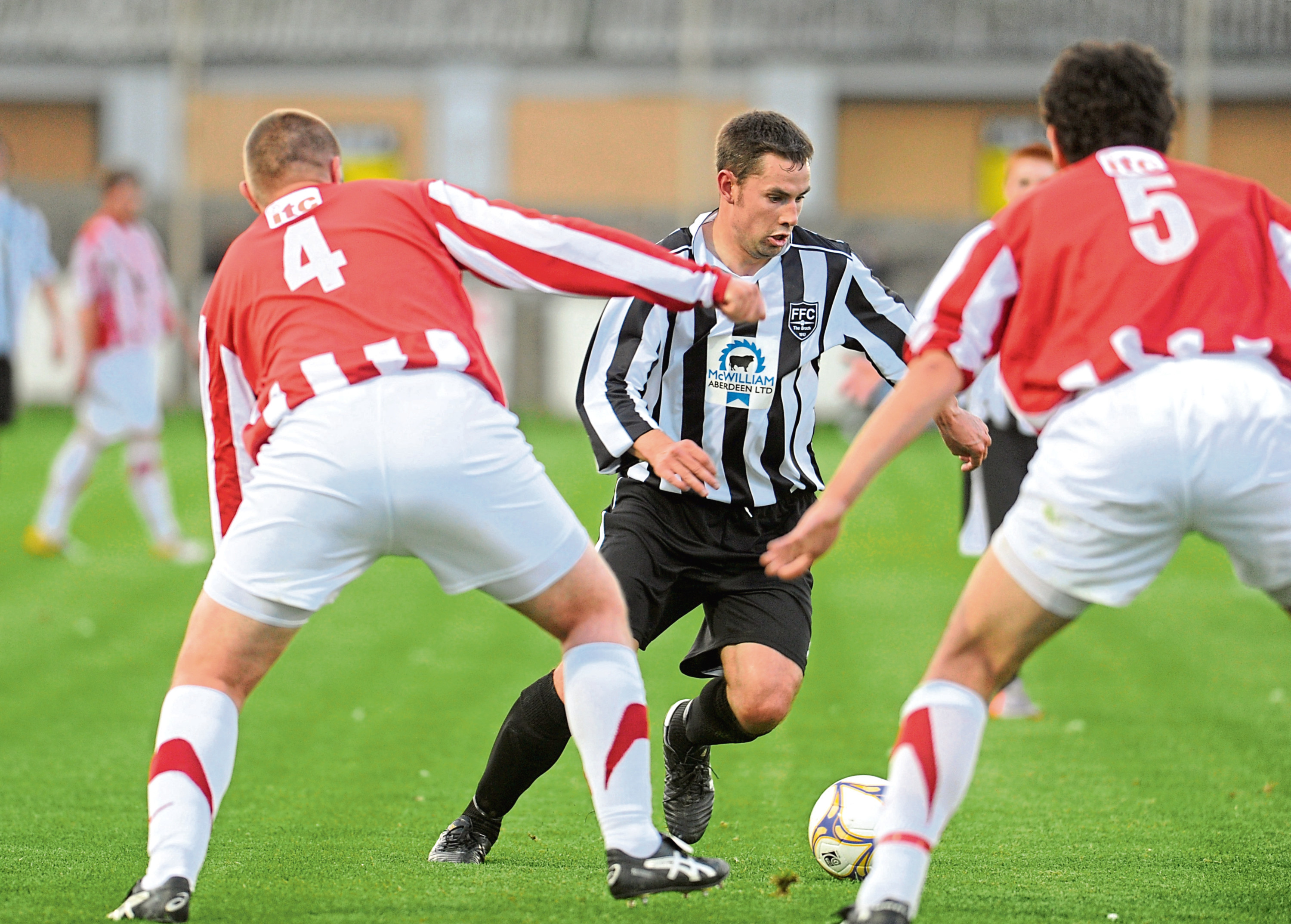 Fraserburgh's Marc Dickson (middle) in action against Formartine United.   Picture by Tim Allen    09/08/11