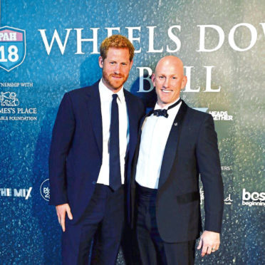 Prince Harry with Dean Stott at the Wheels Down charity ball in London