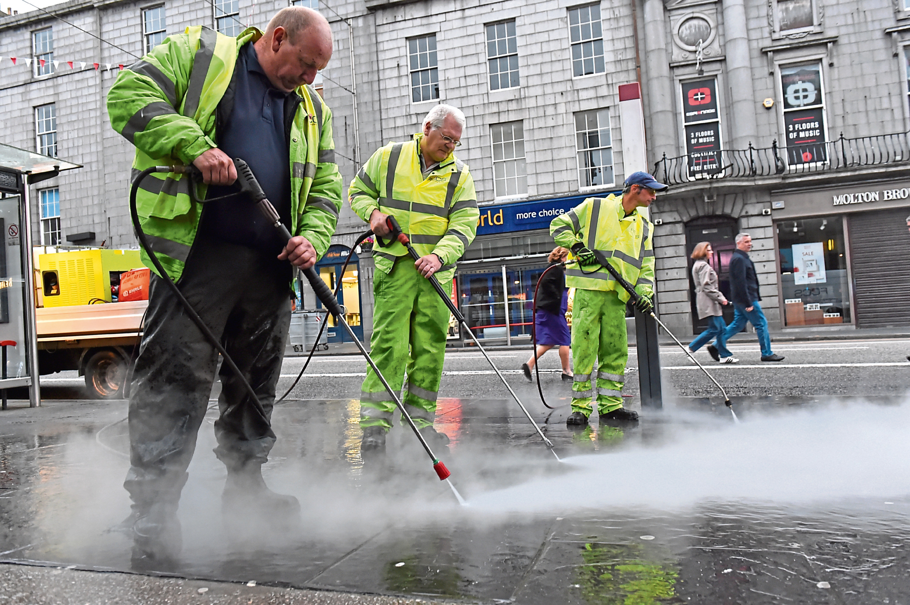 Gum being removed from Union Street