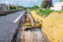 Earth movers can be seen preparing the ground for new track to be laid on the Aberdeen stretch of the improvements between Kittybrewster and Woodside