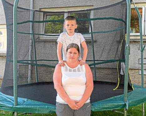 Leanne Grant  has been told to take down her trampoline by the council. Leanne is pictured with her son Dylan