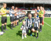 Marc Dickson's testimonial against Peterhead. Marc with his daughter Sydney, 22 months, and nephew Kallan Heap, seven, with the guard of honour Picture by Chris Sumner