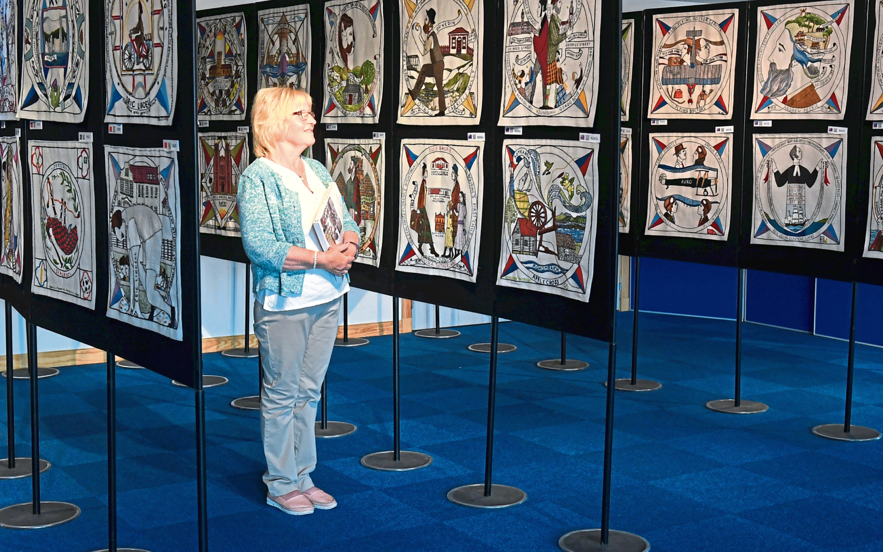 The world famous Diaspora Tapestry is on display at Inveruire Heritage Centre. Pictured is centre volunteer Carol Robertson getting a sneak preview. Pic by Chris Sumner Taken 10/7/18