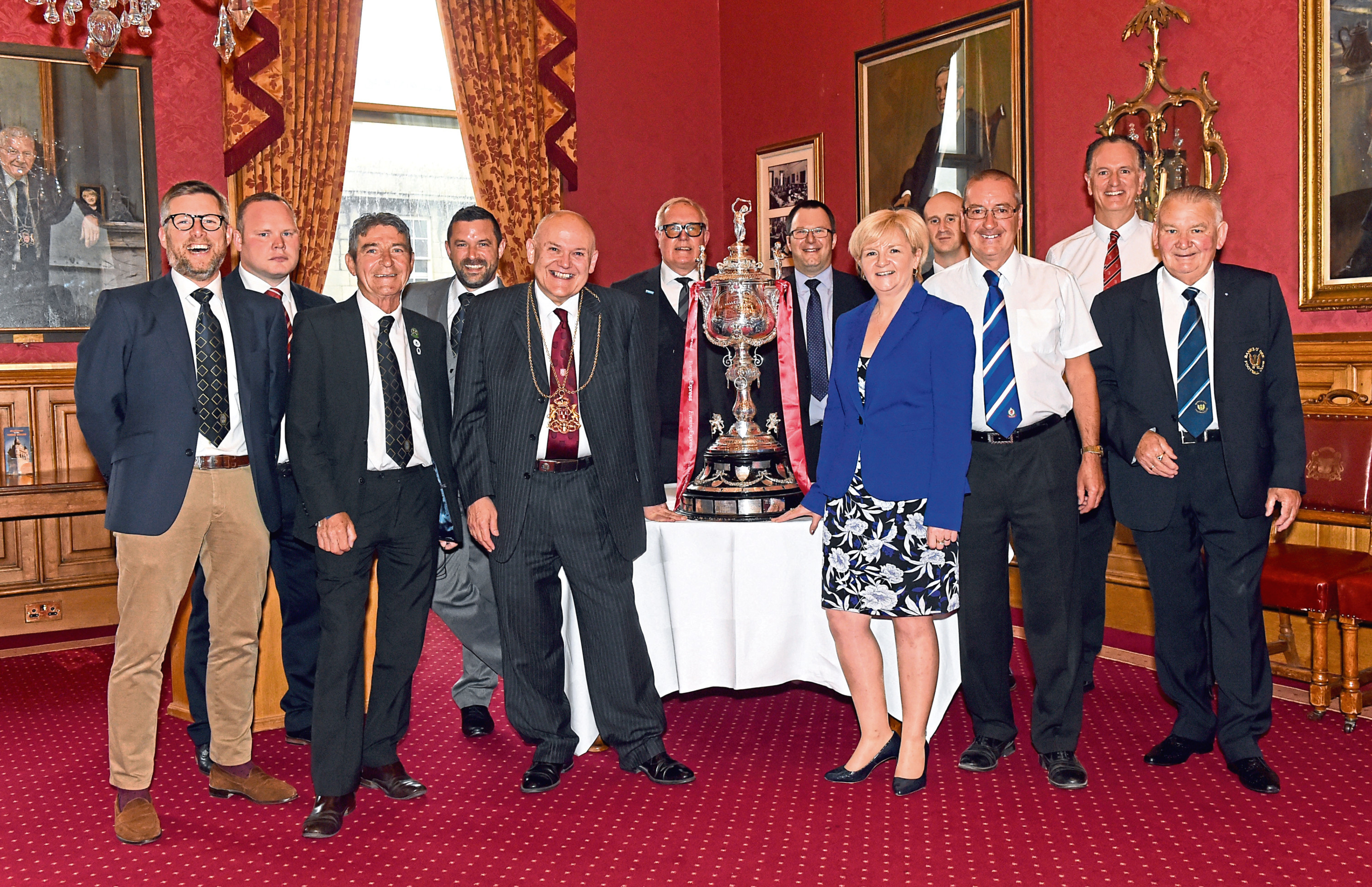 The draw for the Aberdeenshire Cup was made tonight at the Town House by the Lord Provost and Councillor Jenny Laing with various Highland League and other representatives in attendance. Pictured are Lord Provost, Barney Crocket, Councillor Jenny Laing and attendees. Picture by Heather Fowlie