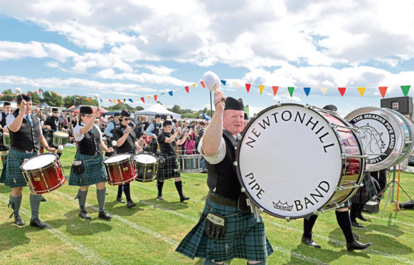 The massed pipe bands perform during last year's games