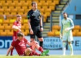 Aberdeen's Stephen Gleeson goes down with an injury.