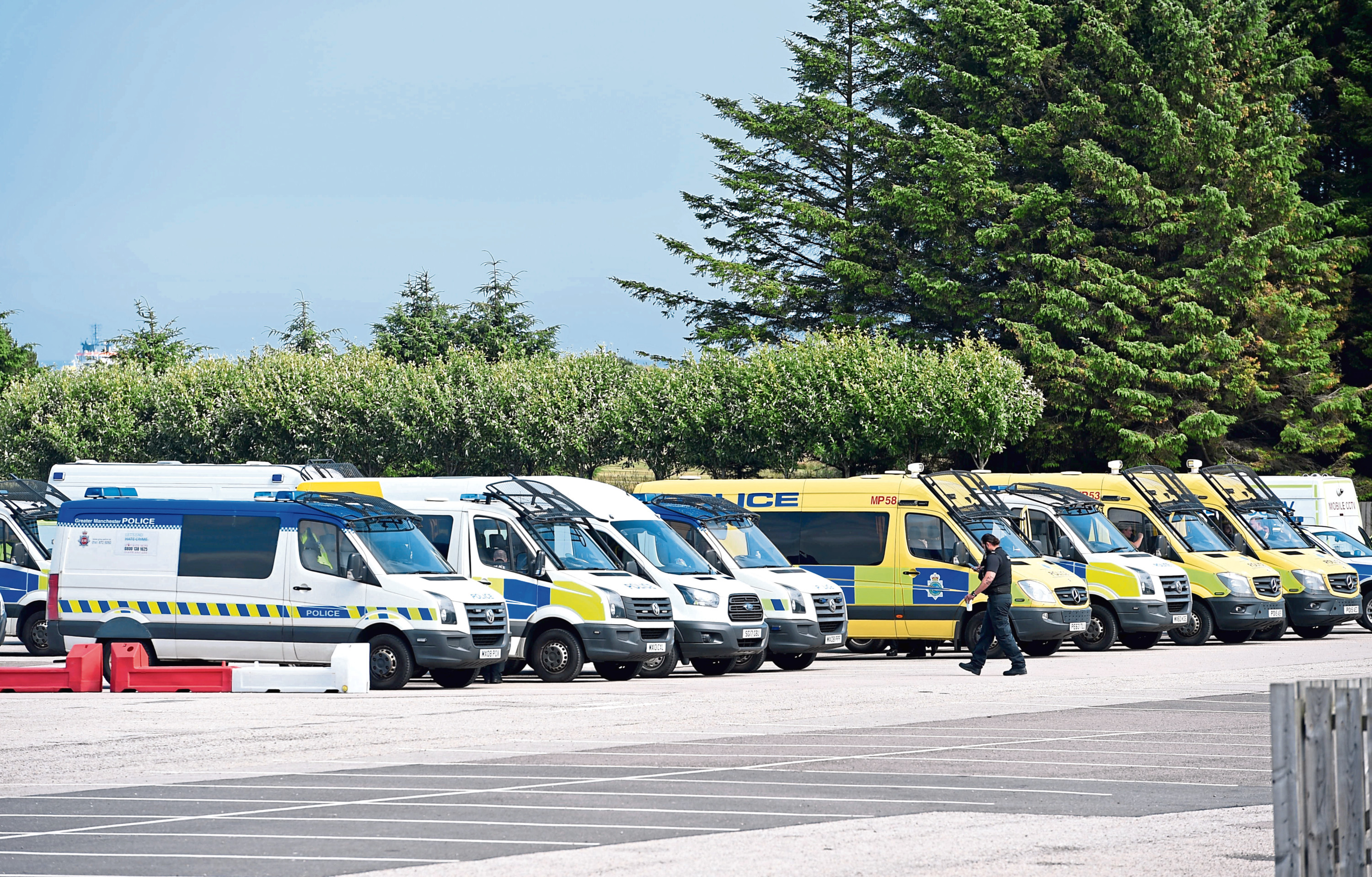 Police riot vans parked at the AECC