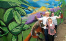 Council co leader Jenny Laing with David Lastowski,  and Rebecca Cuthbert at the new mural at Tullos Community Garden