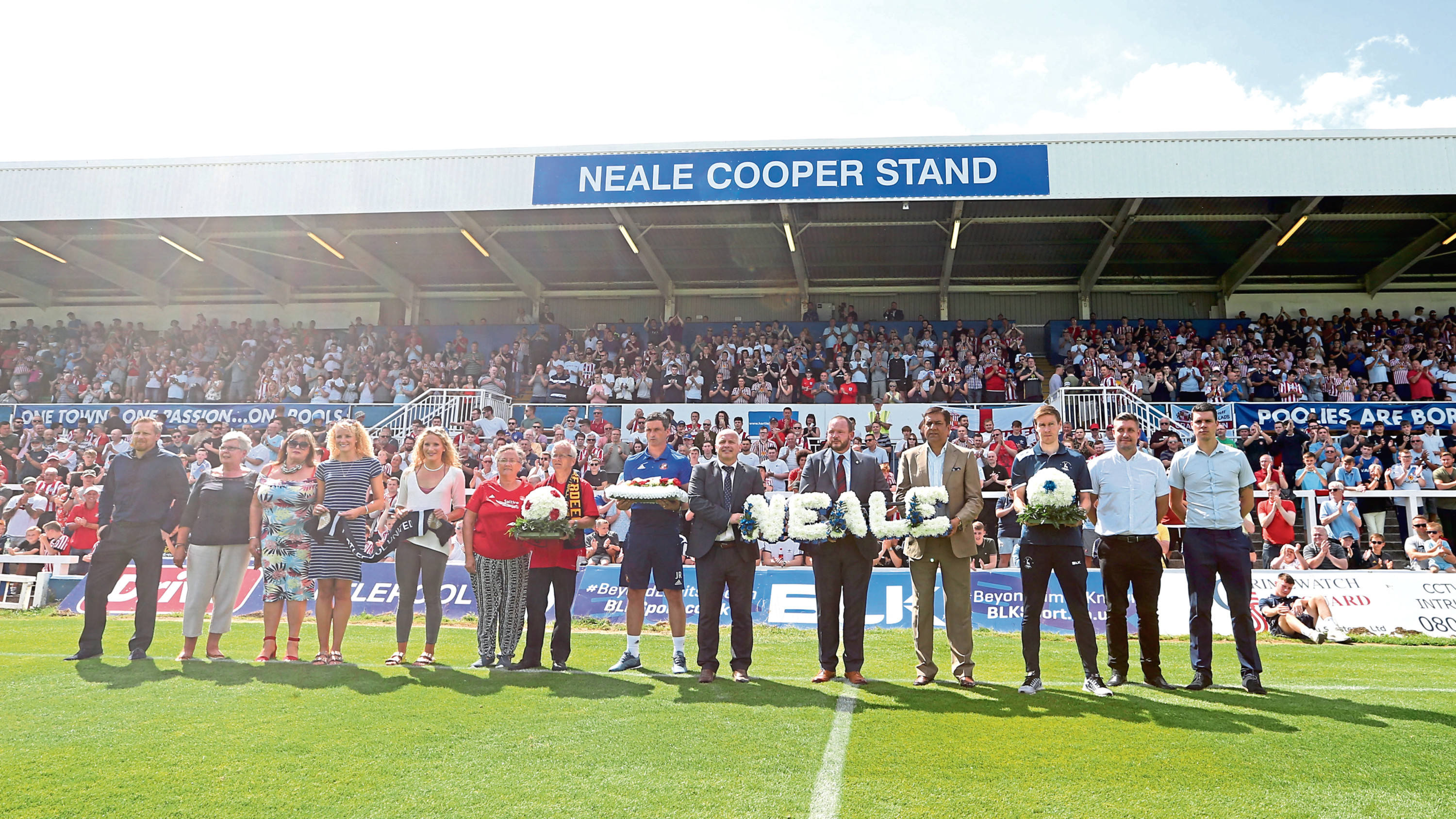 A minute's applause was held before the game