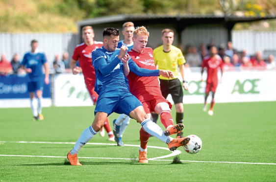 Cove's Connor Scully and Aberdeen's Gary Mackay-Steven