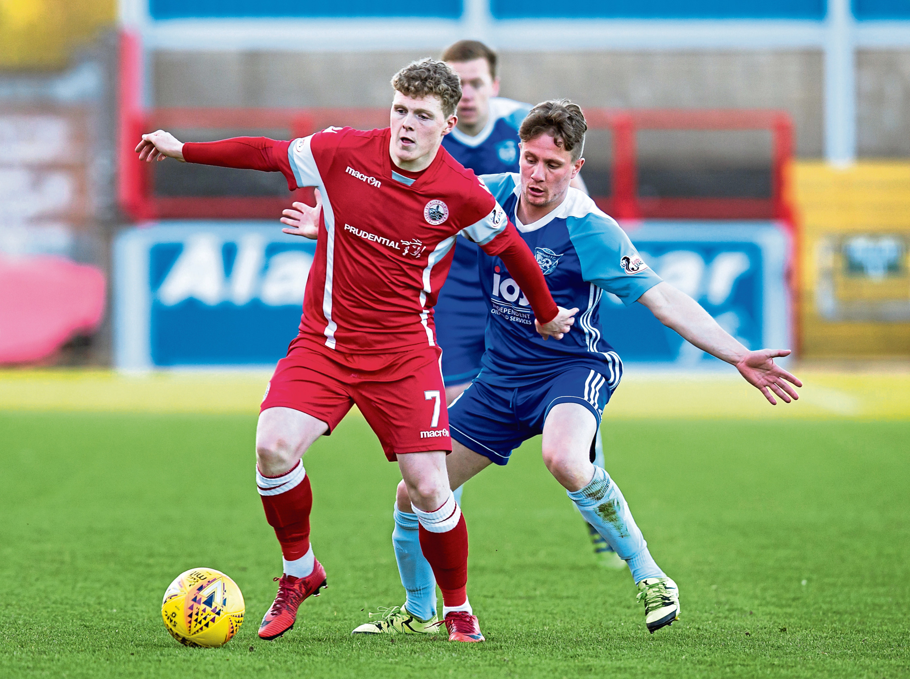 Stirling Albion's Neil McLaughlin in action with Peterhead's Simon Ferry.