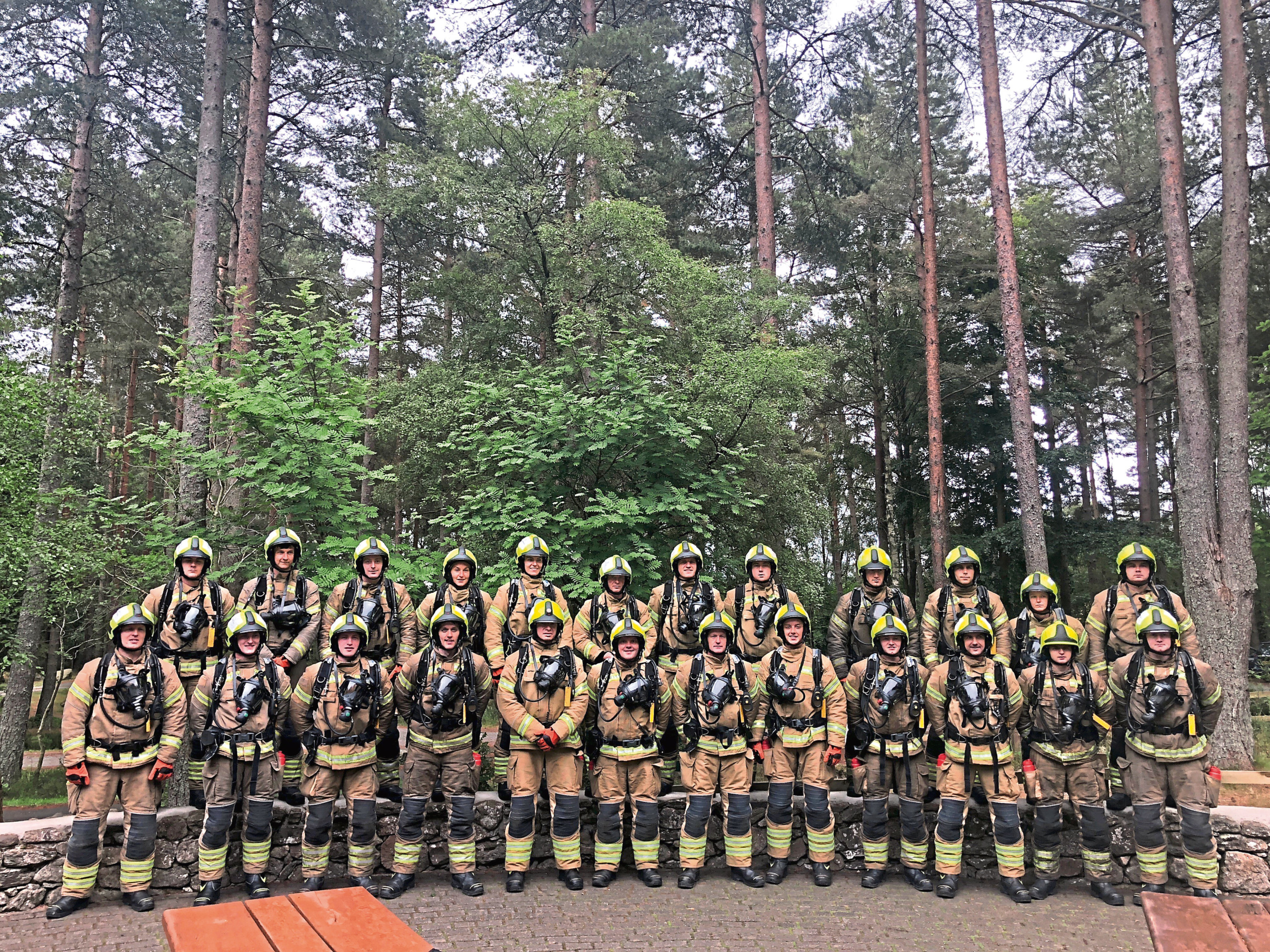 The dedicated group conquered the climb wearing full breathing apparatus, including an oxygen cylinder - weighing in at 25kg