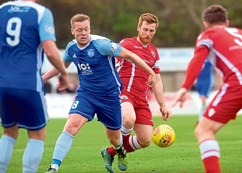 Peterhead's Scott Brown and Albion's Liam Caddis