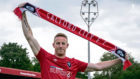 Adam Rooney in Salford City colours after leaving the Dons