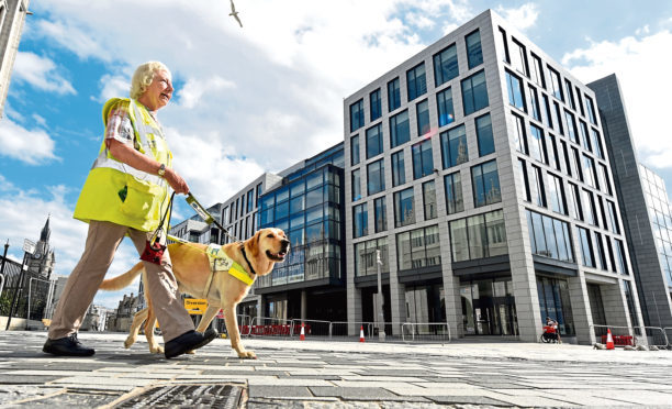 Mary Rasmussen and her guide dog Vince at the Upperkirkgate junction