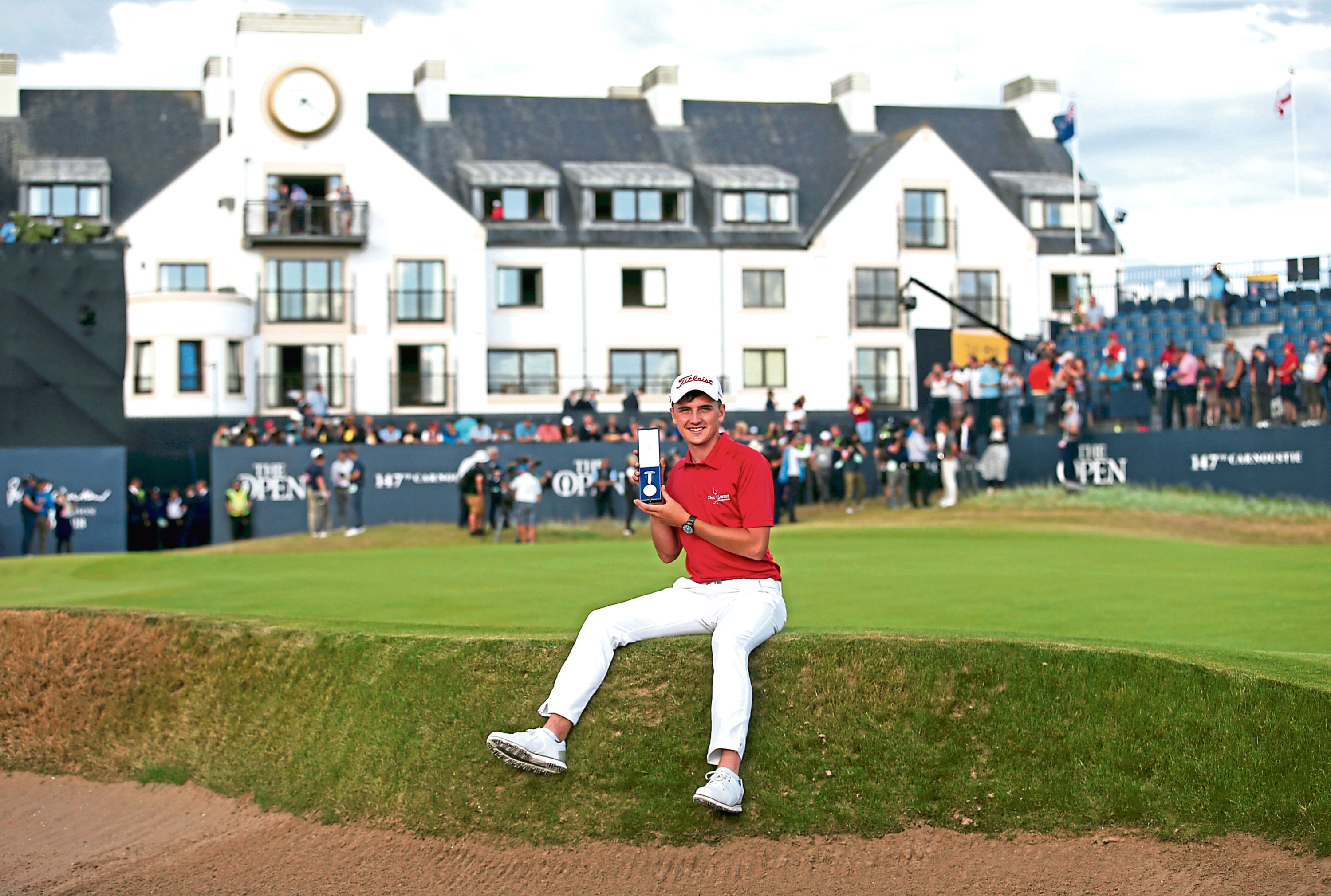 Scotland's Sam Locke with the silver medal for best amateur during day four of The Open Championship 2018