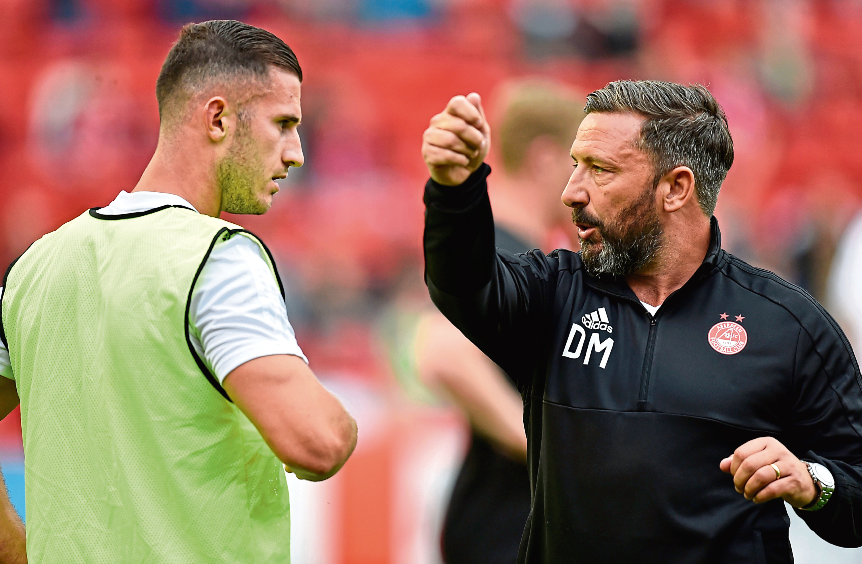 Aberdeen manager Derek McInnes talks to Dom Ball