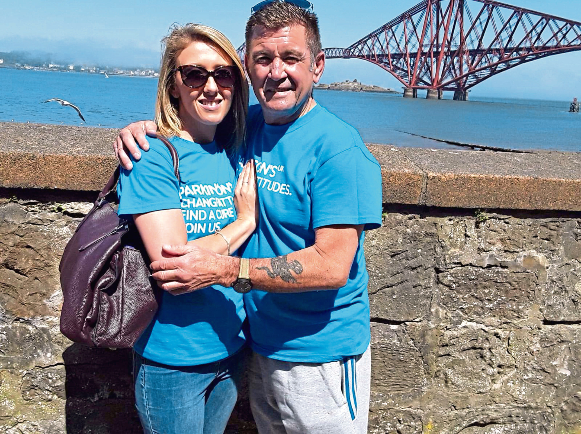 Katies Swales with father Vince, after she completed her abseil on the Forth Rail Bridge