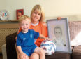 Becky Mennie is organising a charity event to raise money for Fernando Ricksen, the former Rangers captain who has been diagnosed with MND. She is pictured with her son Mason John Fernando, who was named after the player