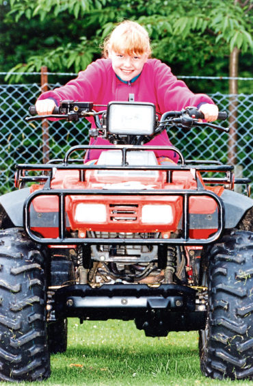 Sarah Rennie from Aberdeen gets to grips with a Honda 350 4 x 4 at Banchory Show