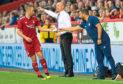 Niall McGinn receives instructions from boss Derek McInnes against Burnley